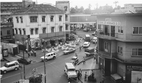 A busy street in Kumasi. Ghana's urban centers are dominated by European-style buildings, a reminder of its British colonizers.